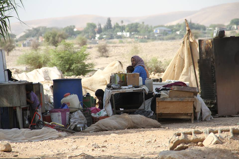 - A family sits with their remains in the Fasayil village of the Jordan Valley on the 18th August, 2015. 20 jeeps were accompanied by six bulldozers to undertake this demolition. Photo credit: Jordan Valley Solidarity campaign.